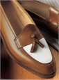 The Split Toe Tassel Loafer in Antique Tan and Cream