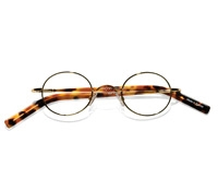Nearly Oval Wire Frame in Gilted Metal with Amber and Tortoise