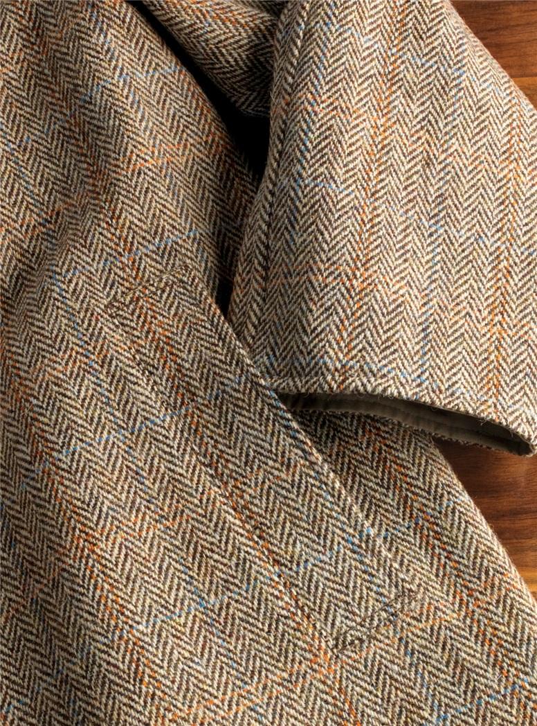 Reversible Herringbone Overcoat and Tan Raincoat