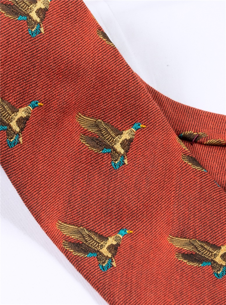 Silk Woven Flying Ducks Motif Tie in Rust